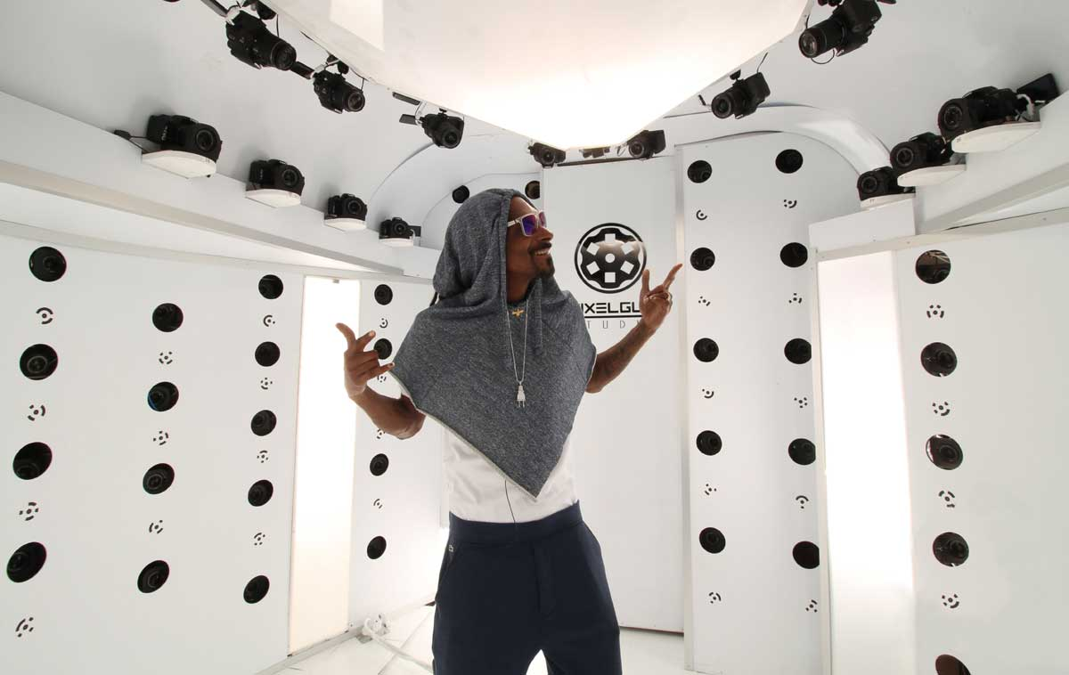 Snoop Dogg gets a 360-degree body scan in a round room with cameras on pointing down at him from the ceiling for a virtual video game appearance.