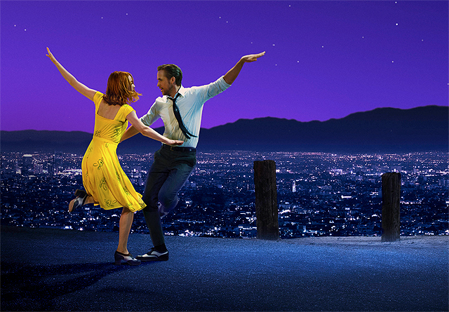 La La Land stars Emma Stone and Ryan Gosling pirouette high above the glittering Los Angeles cityscape at night.
