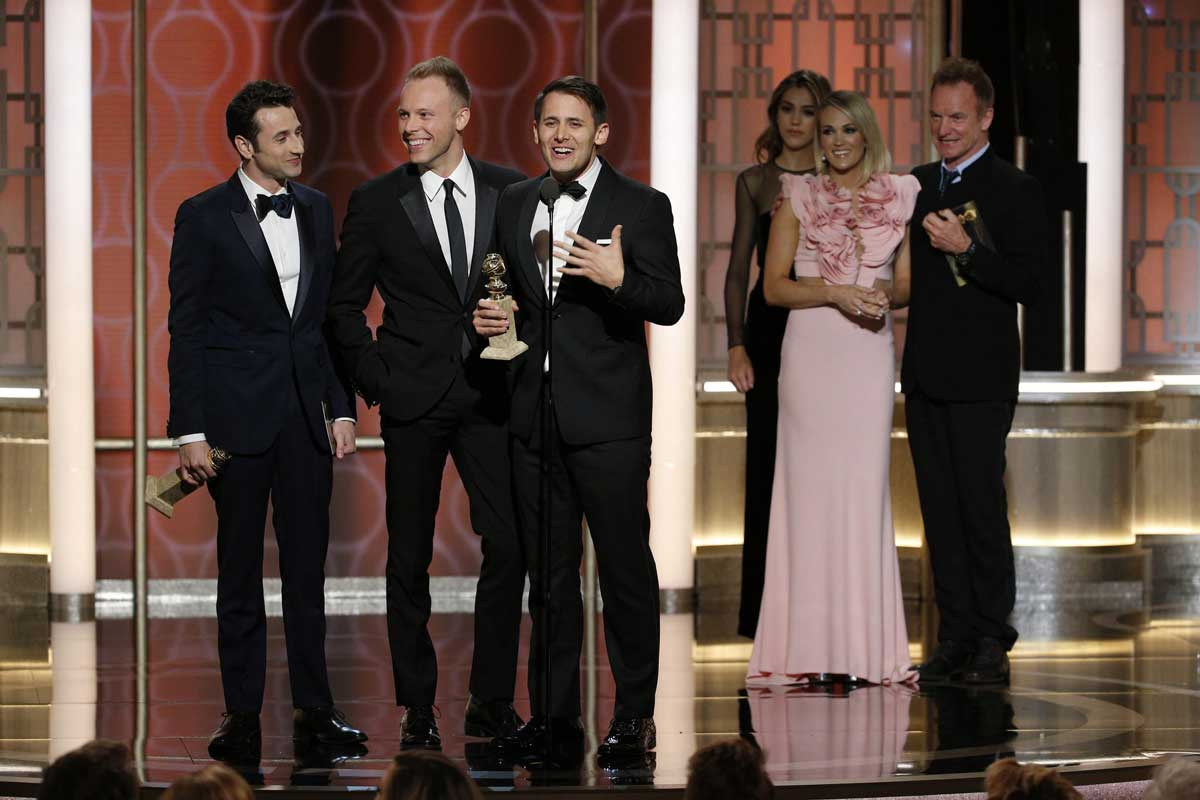 Onstage at the Golden Globes, an elated Justin Hurwitz, Justin Paul and Benj Pasek accept their trophies