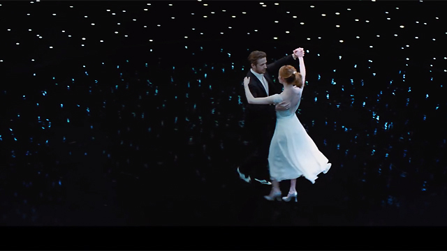ryan gosling and emma stone dance through a starry sky.