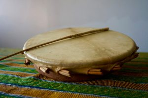 The Sakara is a shallow drum with a circular body made of baked clay.