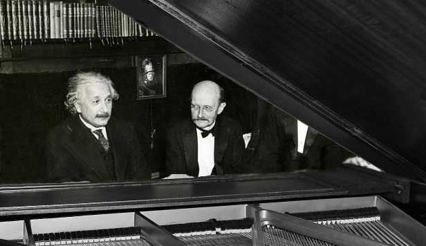 Albert Einstein and Max Planck at the piano