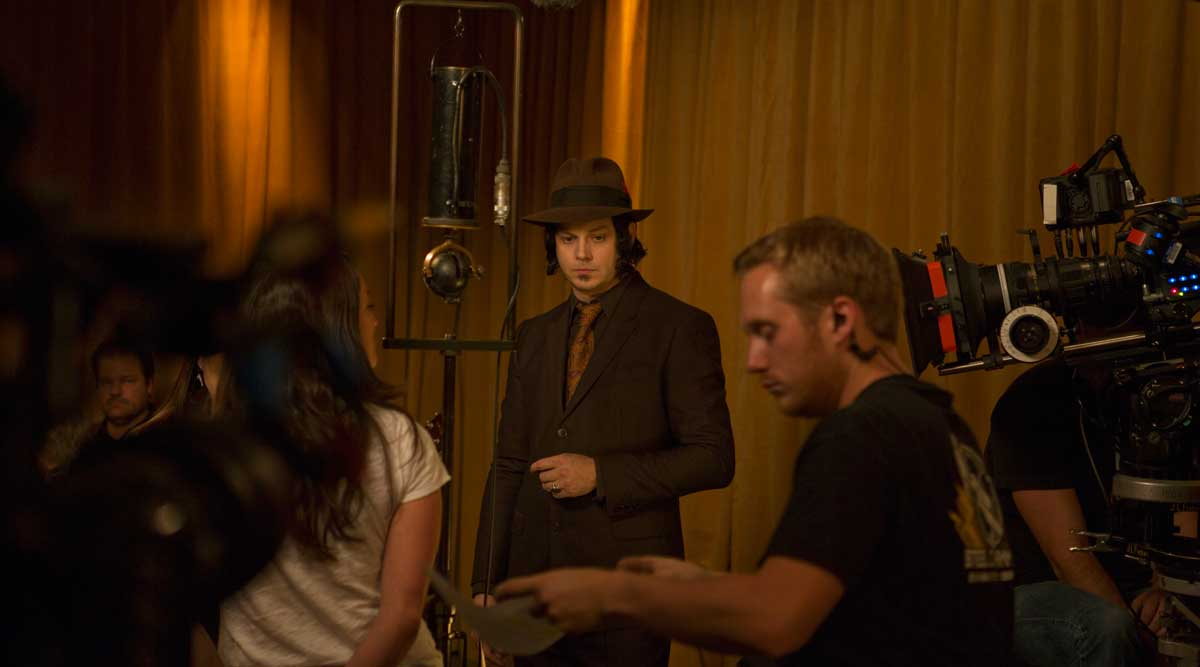 Jack White looks stylish before the cameras in a suit and tie with his trademark fedora.