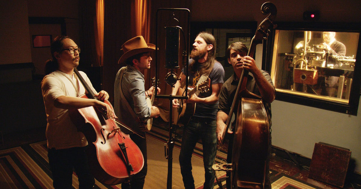 The Avett Brothers perform as a foursome with viola upright bass, banjo and guitar.