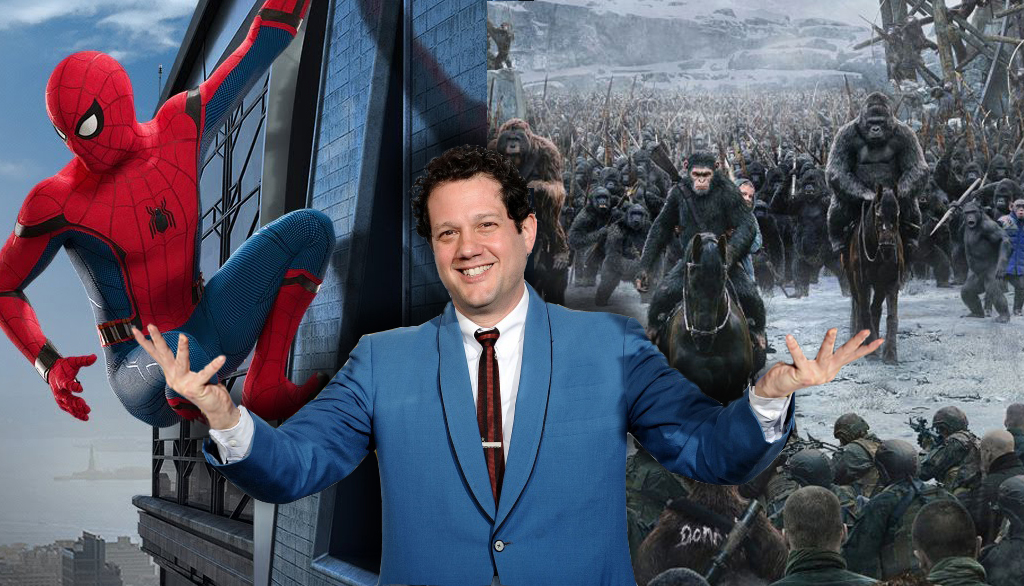 Michael Giacchino in a blue suit in front of images from Spider-Man Homecoming and War for the Planet of the Apes.