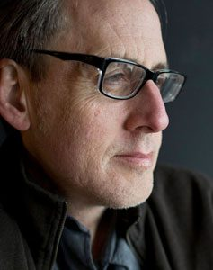 Bespectacled composer Jeff Beal capture in a moment of contemplation.