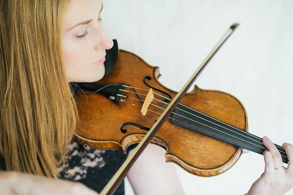 Close-up of Ronit Kirchman playing the violin.