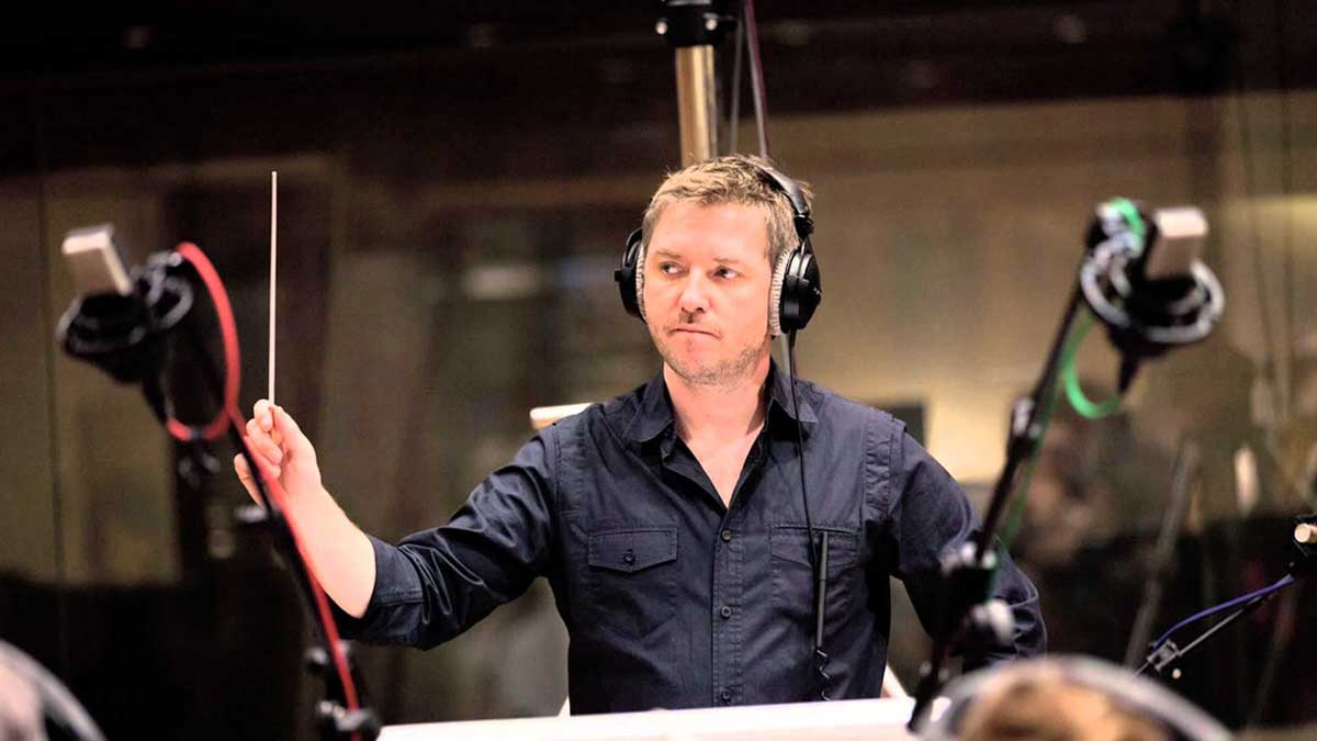 Atli Örvarsson conducts with headset on.