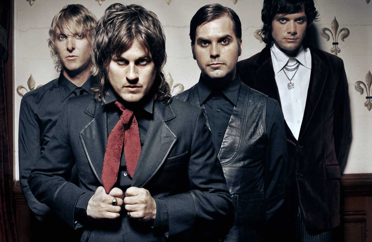 Jason Hill and his band, all in black except for Jason's red tie.