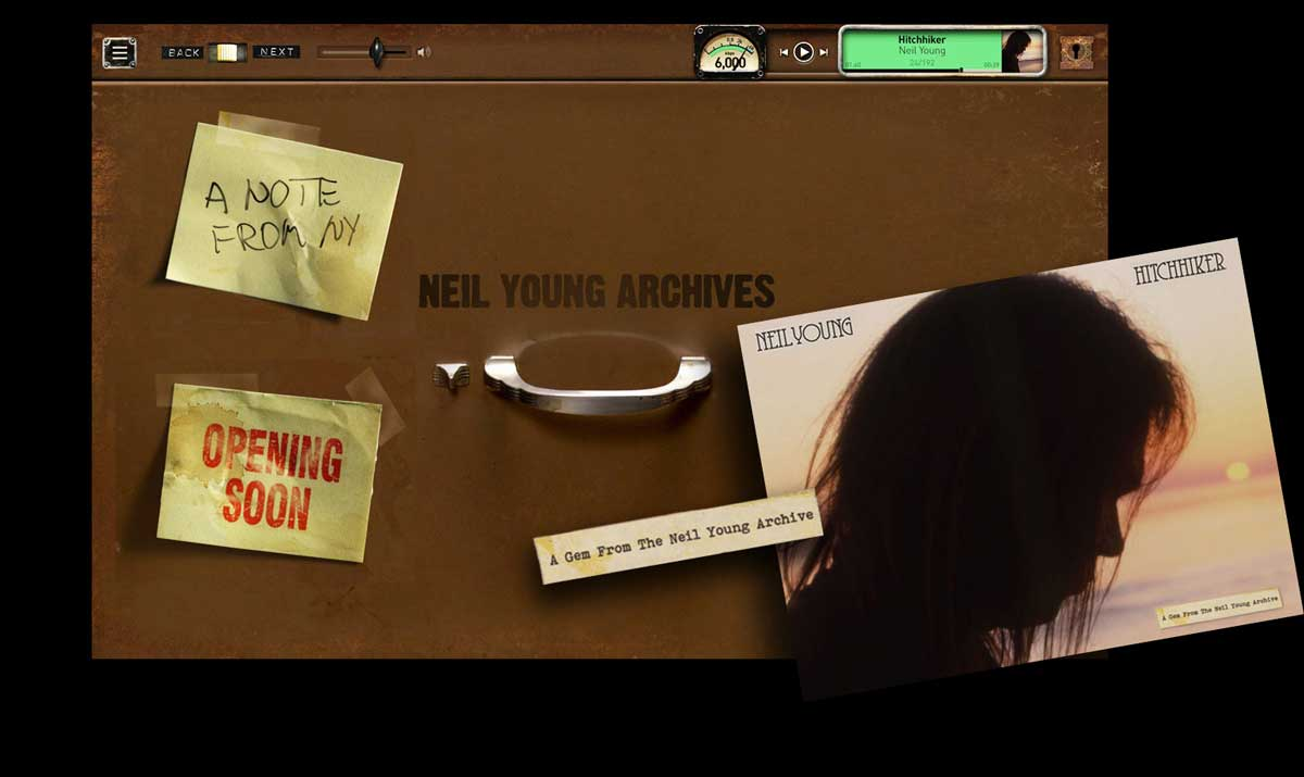 Neil Young Digital Archive landing page looks like an old file cabinet with post-it notes stuck on