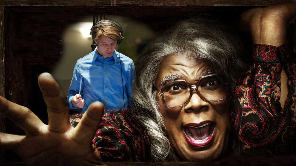 Composer Philip White conducts over Madea